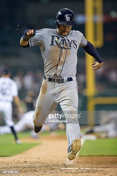 Kevin Kiermaier of the Tampa Bay Rays scores in the top of the ninth inning to tie the score 77 and push the game to extra innings during a MLB game...