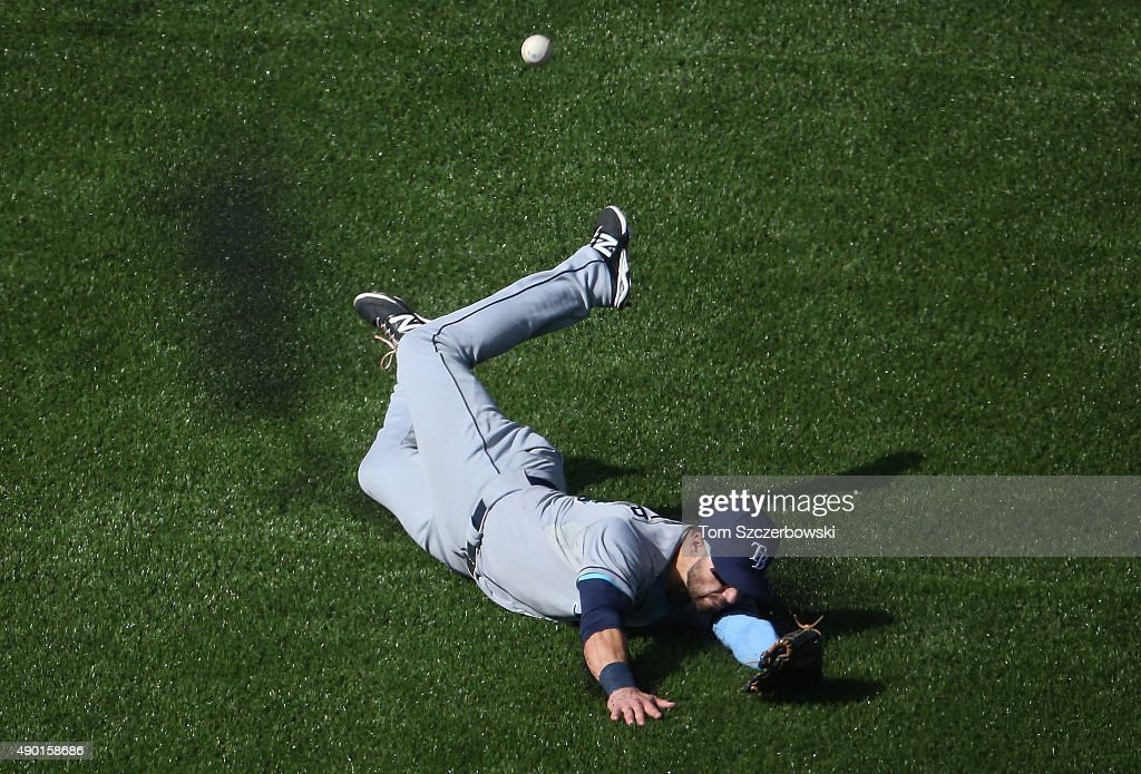 Kevin Kiermaier #39 of the Tampa Bay Rays slides but cannot get to an RBI double hit by Kevin Pillar #11 of the Toronto Blue Jays in the third inning during MLB game action on September 26, 2015 at Rogers Centre in Toronto, Ontario, Canada.