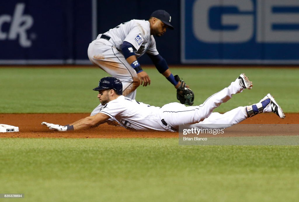 Kevin Kiermaier #39 of the Tampa Bay Rays slides safely into second base ahead of second baseman Robinson Cano #22 of the Seattle Mariners after hitting a double off of pitcher Erasmo Ramirez during the sixth inning of a game on August 18, 2017 at Tropicana Field in St. Petersburg, Florida.