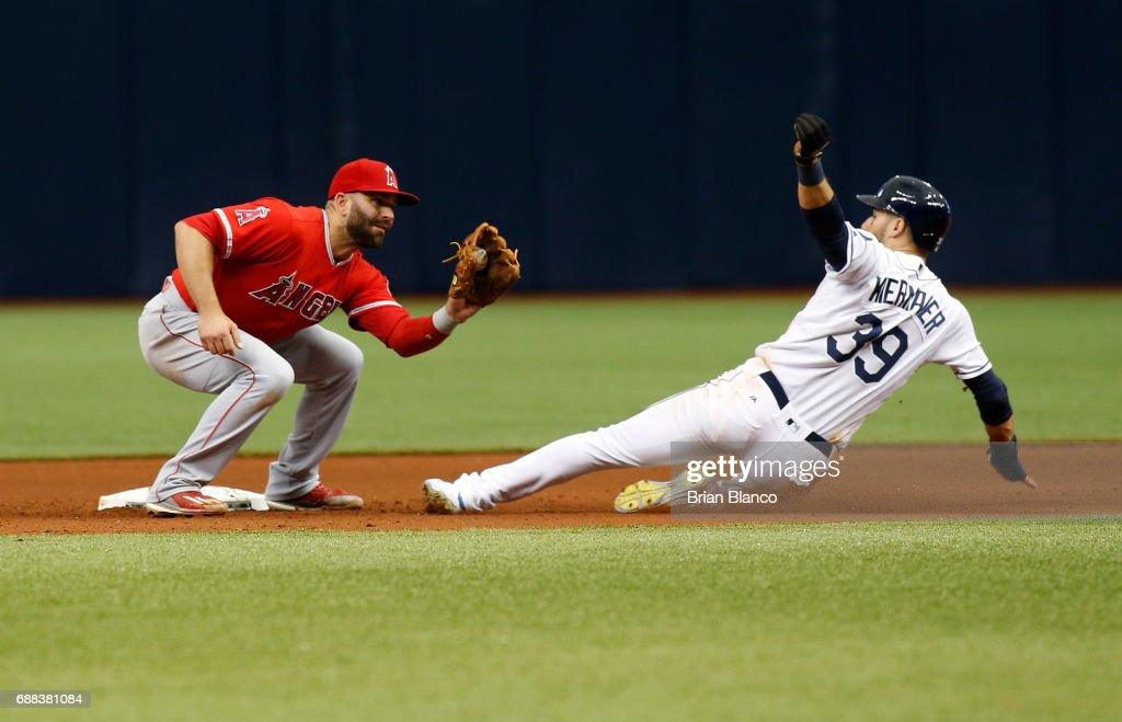 Kevin Kiermaier #39 of the Tampa Bay Rays steals second base ahead of second baseman Danny Espinosa #3 of the Los Angeles Angels of Anaheim during the seventh inning of a game on May 25, 2017 at Tropicana Field in St. Petersburg, Florida.