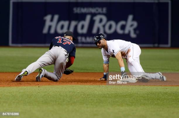 Kevin Kiermaier of the Tampa Bay Rays steals second base ahead of second baseman Deven Marrero of the Boston Red Sox during the ninth inning of a...