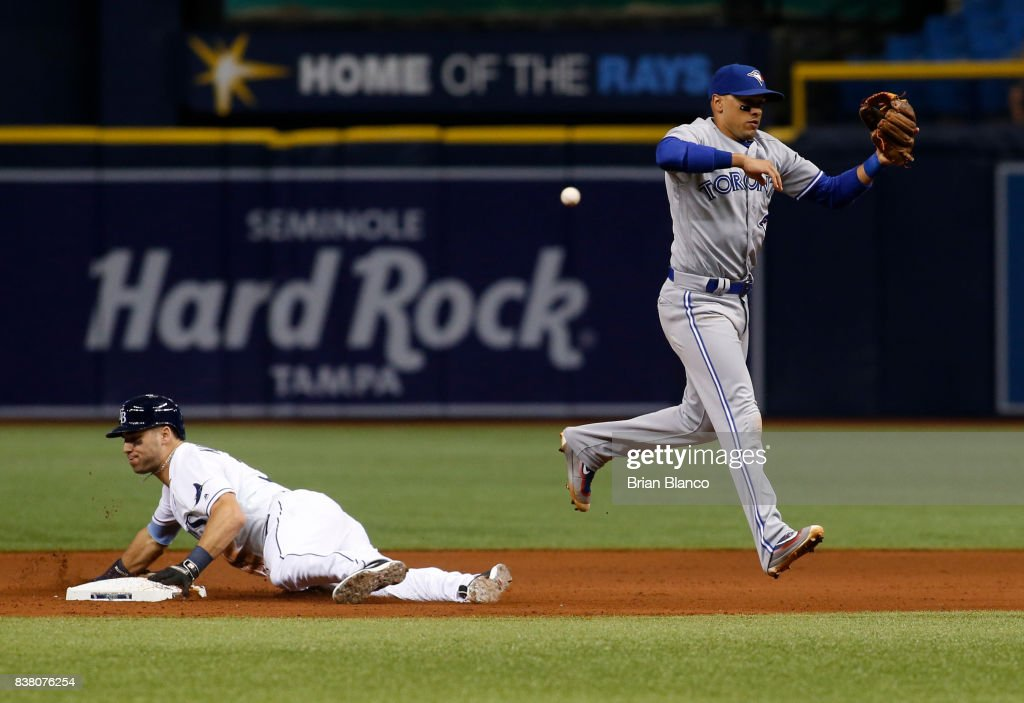 Kevin Kiermaier #39 of the Tampa Bay Rays steals second base as shortstop Ryan Goins #17 of the Toronto Blue Jays attempts to haul in the throwing error by catcher Raffy Lopez, allowing Kiermaier to then advance to third base during the seventh inning of a game on August 23, 2017 at Tropicana Field in St. Petersburg, Florida.