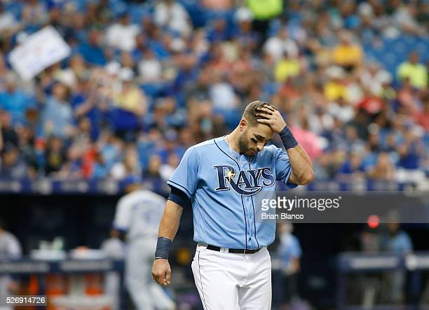 Kevin Kiermaier of the Tampa Bay Rays walks toward the dugout after striking out swinging to end the seventh inning of a game against the Toronto...