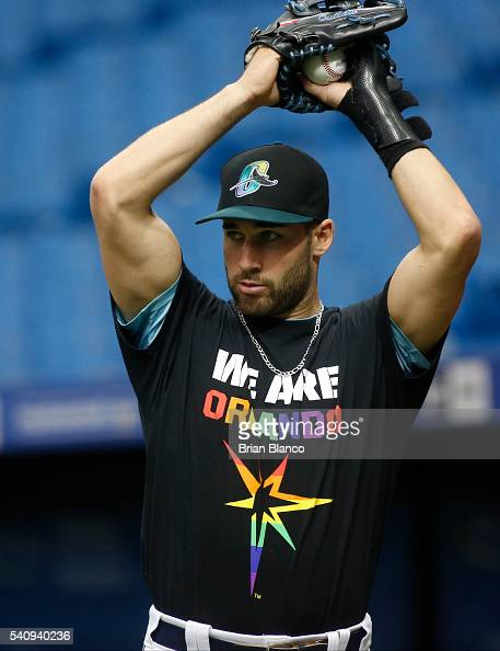 Kevin Kiermaier of the Tampa Bay Rays wears a We Are Orlando tshirt to honor the victims of the Orlando nightclub shooting before the game against...