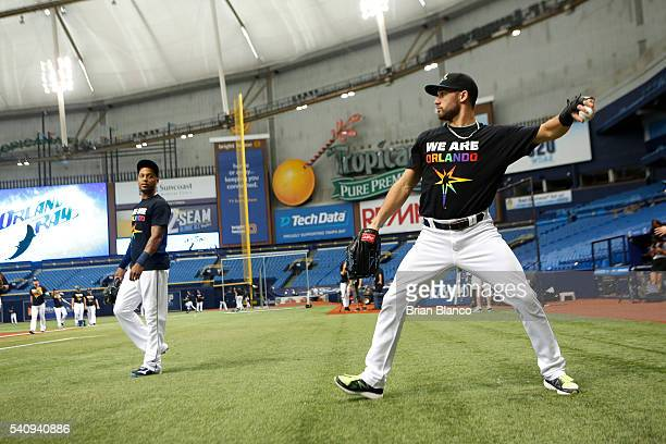 Kevin Kiermaier right of the Tampa Bay Rays and teammate Desmond Jennings wears We Are Orlando tshirts during warm ups in honor of the victims of the...
