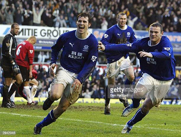 Kevin Kilbane and Wayne Rooney of Everton celebrate scoring their 3rd goal during the FA Barclaycard Premiership match between Everton and Manchester...