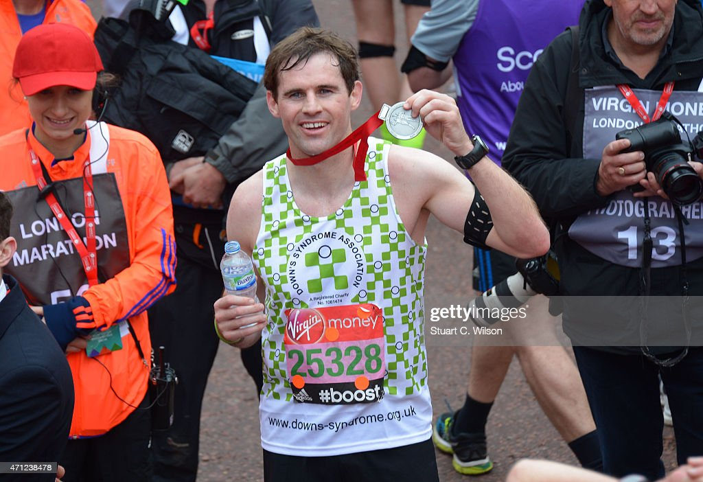 Kevin Kilbane poses at the finish line during The London Marathon 2015 on April 26, 2015 in London, England.