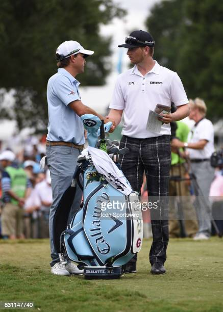 Kevin Kisner and Chris Stroud shake hands before teeing off on the 1st hole during the final round of the PGA Championship on August 13 2017 at Quail...