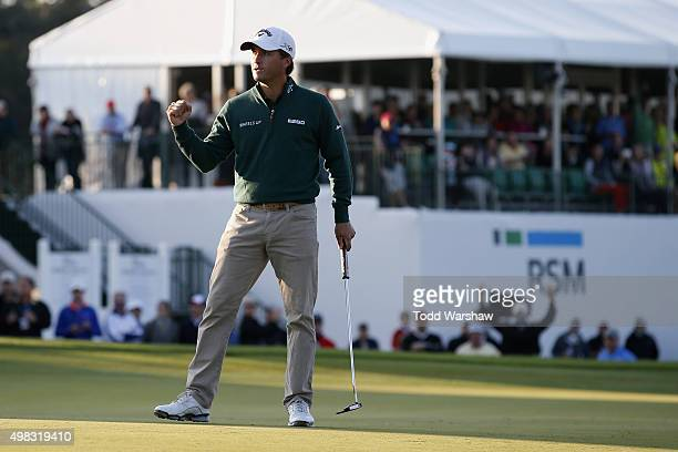 Kevin Kisner celebrates on the 18th green of the Seaside Course after winning The RSM Classic on November 22 2015 in St Simons Island Georgia