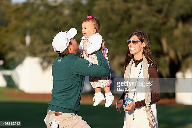 Kevin Kisner celebrates with his daughter Kathleen and wife Brittany on the 18th green of the Seaside Course after winning The RSM Classic on...