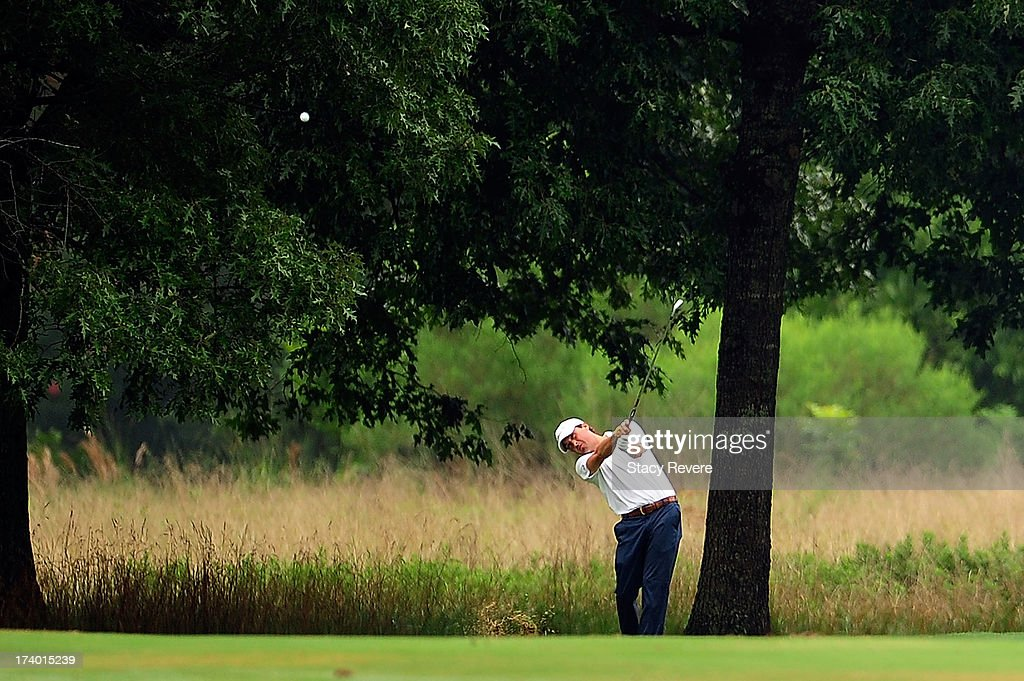 Kevin Kisner hits his second shot on the 16th hole during a continuation of the first round of the Sanderson Farms Championship at Annandale Golf Club on July 19, 2013 in Madison, Mississippi.