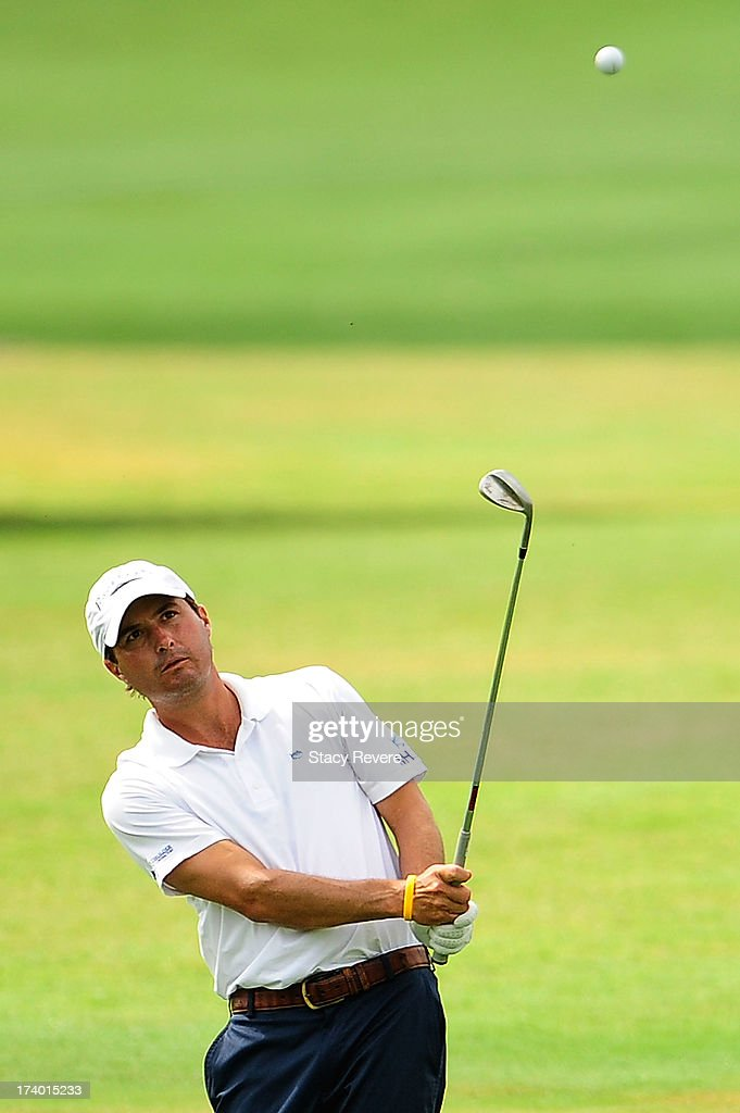 Kevin Kisner hits his third shot on the 18th hole during a continuation of the first round of the Sanderson Farms Championship at Annandale Golf Club on July 19, 2013 in Madison, Mississippi.