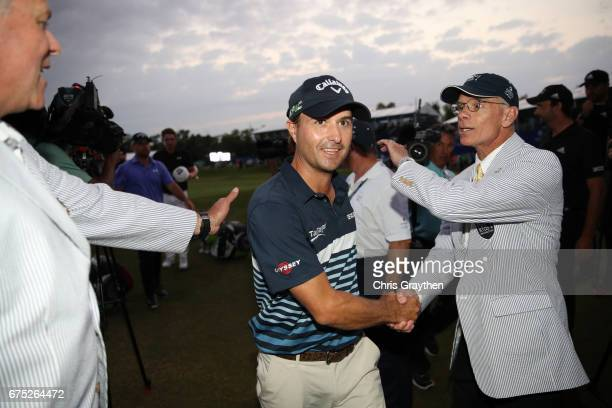Kevin Kisner leaves the course after making an eagle putt to tie on the 18th hole during the final round of the Zurich Classic at TPC Louisiana on...