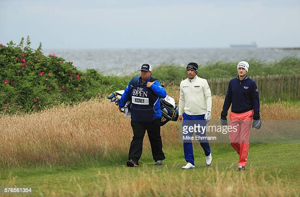 Kevin Kisner of the United States and Russell Knox of Scotland walk off the 2nd during the third round on day three of the 145th Open Championship at...