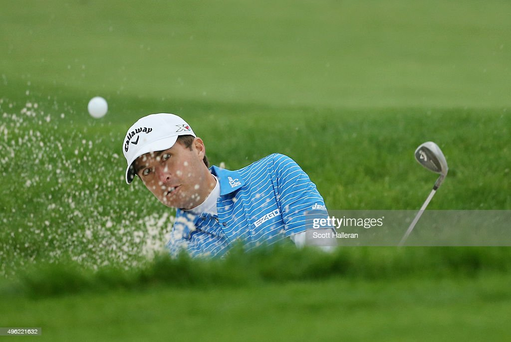 Kevin Kisner of the United States hits a bunker shot on the 14th hole during the final round of the WGC HSBC Champions at the Sheshan International...