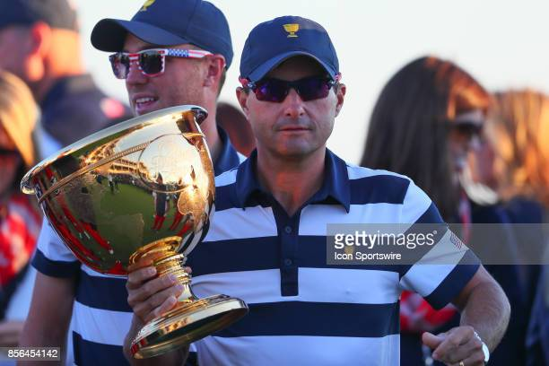 Kevin Kisner of the United States holds the Presidents Cup Trophy after the Presidents Cup on October 1 at Liberty National Golf Clubin Jersey City NJ