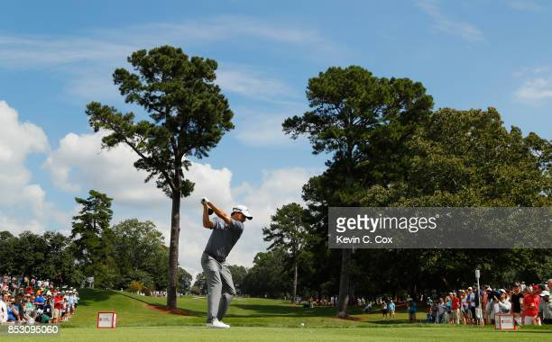 Kevin Kisner of the United States plays his shot from the fourth tee during the final round of the TOUR Championship at East Lake Golf Club on...