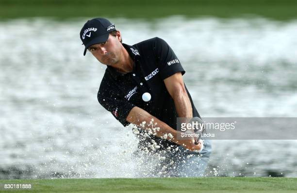 Kevin Kisner of the United States plays his shot out of the bunker on the 17th hole during the second round of the 2017 PGA Championship at Quail...