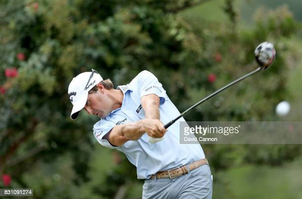 Kevin Kisner of the United States plays his tee shot on the par 4 second hole during the final round of the 2017 PGA Championship at Quail Hollow on...