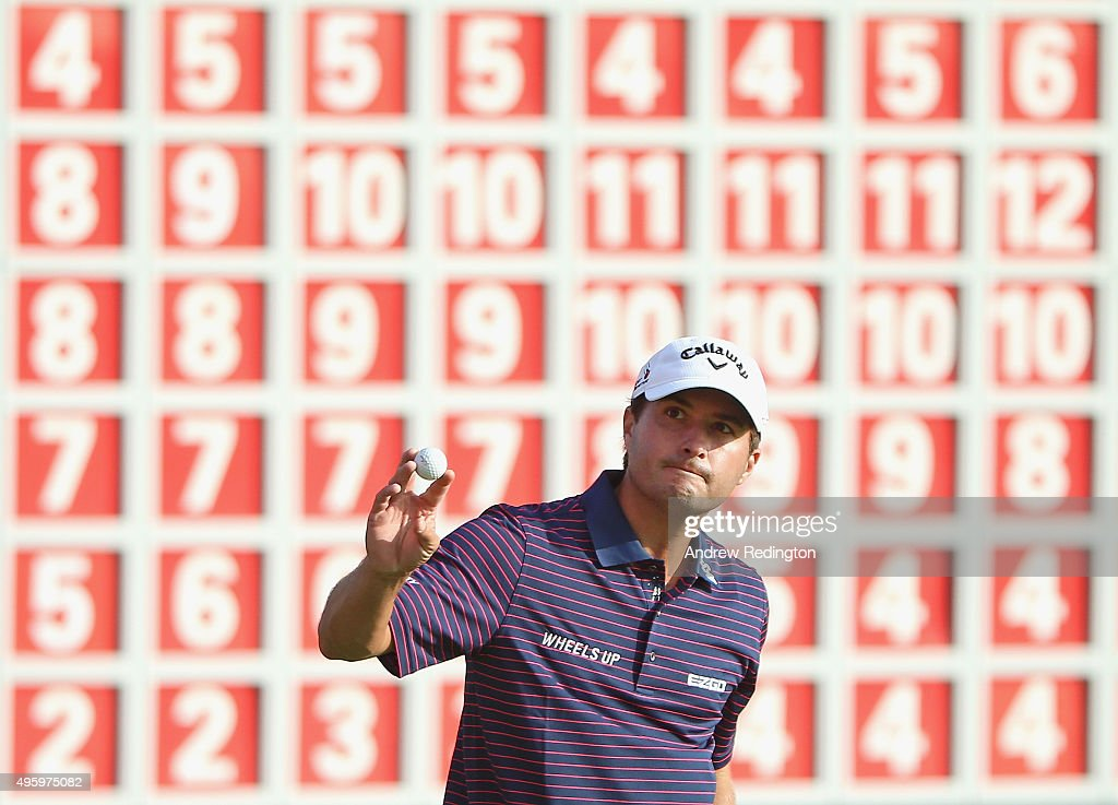 Kevin Kisner of the USA waves to the crowd after putting out on the 18th hole during the second round of the WGC HSBC Champions at the Sheshan...
