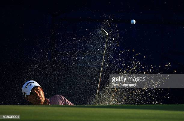 Kevin Kisner plays a shot from a bunker on the 17th hole during the first round of the Sony Open In Hawaii at Waialae Country Club on January 14 2016...