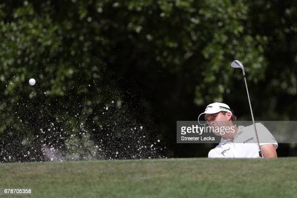 Kevin Kisner plays a shot from a bunker on the ninth hole during round one of the Wells Fargo Championship at Eagle Point Golf Club on May 4 2017 in...
