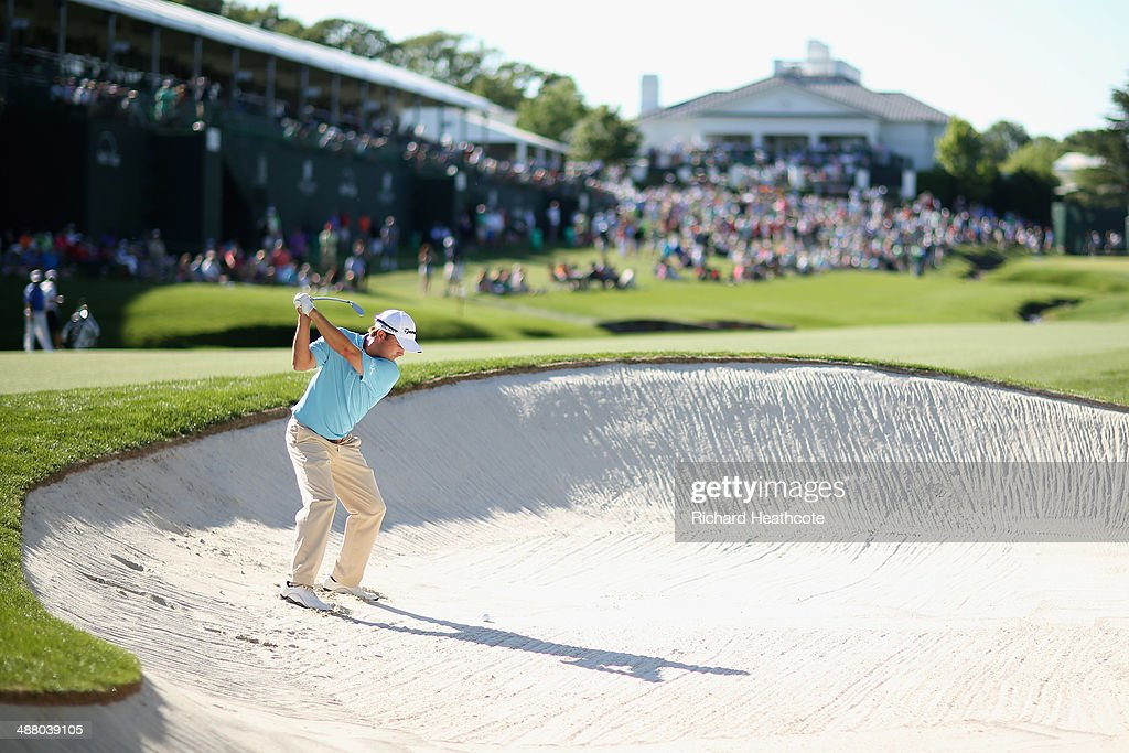 <a gi-track='captionPersonalityLinkClicked' href=/galleries/search?phrase=Kevin+Kisner&family=editorial&specificpeople=2314761 ng-click='$event.stopPropagation()'>Kevin Kisner</a> plays from a bunker on the 18th during the third round of the Wells Fargo Championship at the Quail Hollow Club on May 3, 2014 in Charlotte, North Carolina.