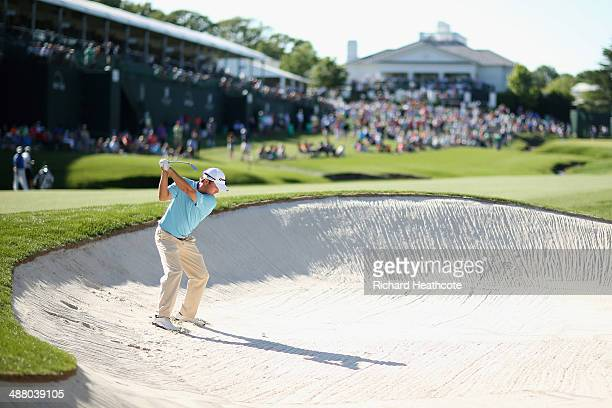 Kevin Kisner plays from a bunker on the 18th during the third round of the Wells Fargo Championship at the Quail Hollow Club on May 3 2014 in...