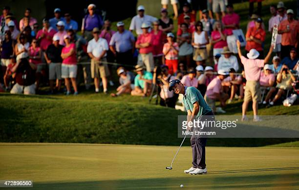 Kevin Kisner putts on the 16th green during a playoff during the final round of THE PLAYERS Championship at the TPC Sawgrass Stadium course on May 10...