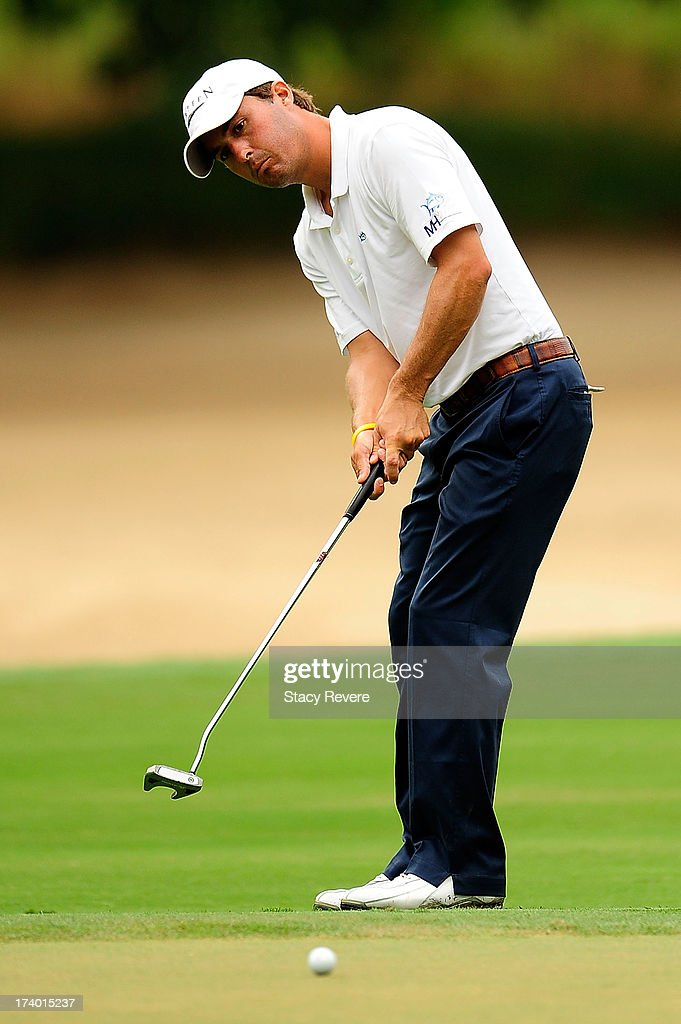 Kevin Kisner putts on the 16th hole during a continuation of the first round of the Sanderson Farms Championship at Annandale Golf Club on July 19, 2013 in Madison, Mississippi.