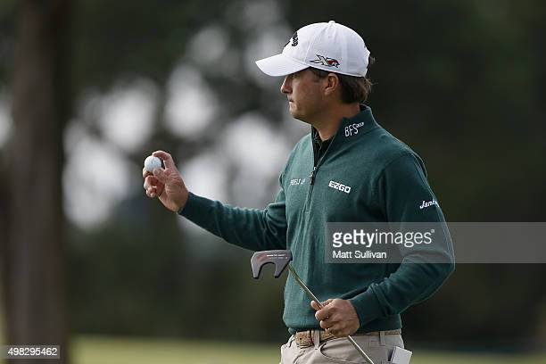 Kevin Kisner reacts after a birdie putt on the 8th green on the Seaside Course during the final round of The RSM Classic on November 22 2015 in St...