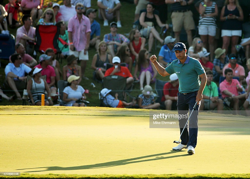 Kevin Kisner reacts after putting for birdie on the 17th green during the final round of THE PLAYERS Championship at the TPC Sawgrass Stadium course...