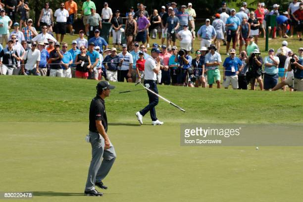 Kevin Kisner who is the current leader reacts to missing a putt by tossing his putter in the air on the 18th hole during the second round of the PGA...