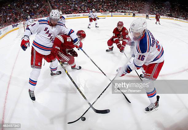 Kevin Klein and Derick Brassard of the New York Rangers control the puck under pressure from Martin Erat and Antoine Vermette of the Arizona Coyotes...