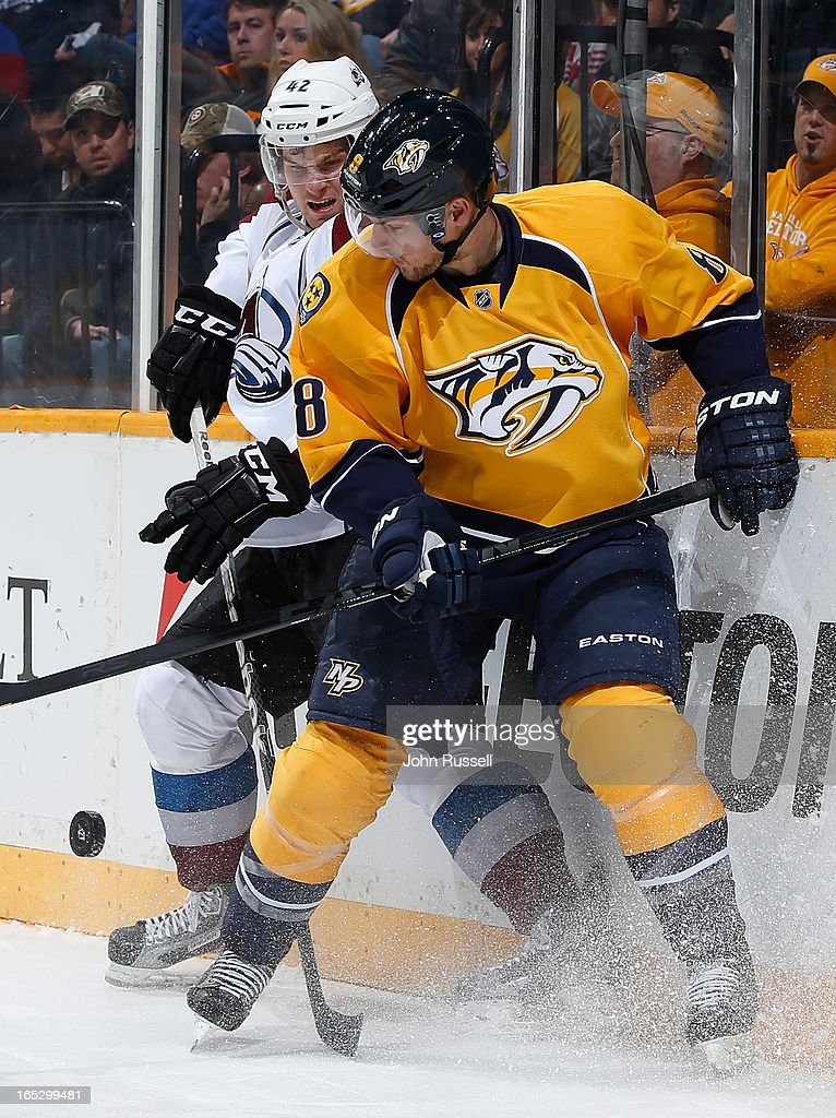 Kevin Klein #8 of the Nashville Predators battles along the boards against Brad Malone #42 of the Colorado Avalanche during an NHL game at the Bridgestone Arena on April 2, 2013 in Nashville, Tennessee.