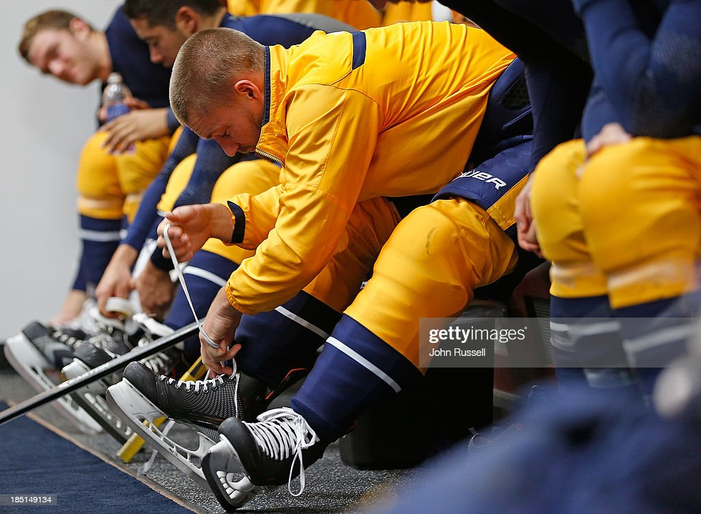 Kevin Klein #8 of the Nashville Predators laces his skates prior to a game against the Los Angeles Kings at Bridgestone Arena on October 17, 2013 in Nashville, Tennessee.
