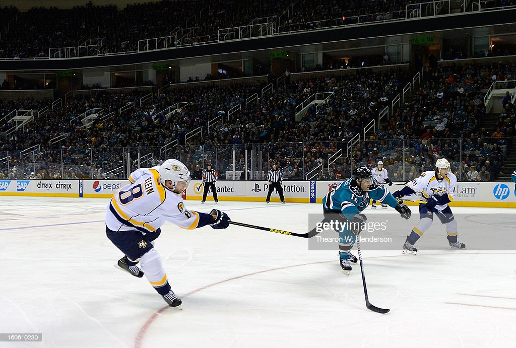 Kevin Klein #8 of the Nashville Predators shoots on goal past Patrick Marleau #12 of the San Jose Sharks at HP Pavilion on February 2, 2013 in San Jose, California.