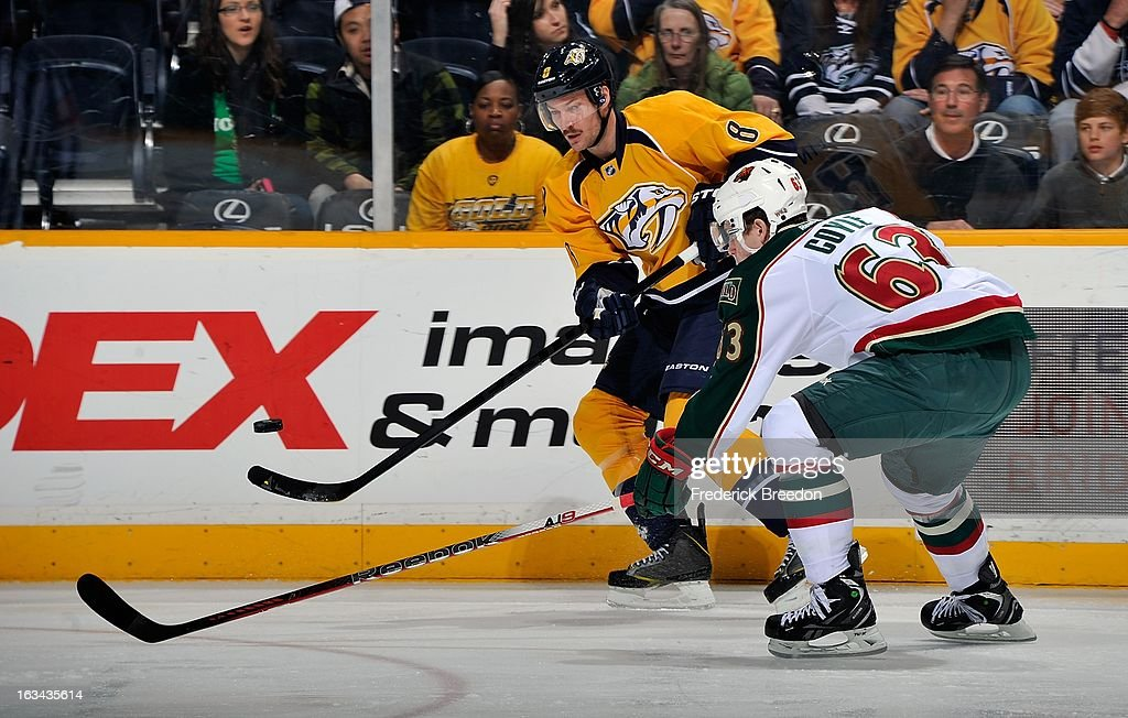 Kevin Klein #8 of the Nashville Predators skates against Charlie Coyle #63 of the Minnesota Wild at Bridgestone Arena on March 9, 2013 in Nashville, Tennessee.