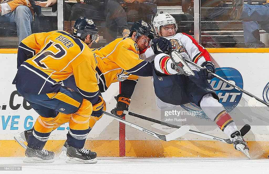 Kevin Klein #8 of the Nashville Predators upends <a gi-track='captionPersonalityLinkClicked' href=/galleries/search?phrase=Aleksander+Barkov&family=editorial&specificpeople=8760147 ng-click='$event.stopPropagation()'>Aleksander Barkov</a> #16 of the Florida Panthers at Bridgestone Arena on October 15, 2013 in Nashville, Tennessee.