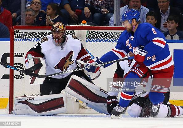 Kevin Klein of the New York Rangers attempts to deflect a shot by Ryan McDonagh against Mike Smith of the Arizona Coyotes at Madison Square Garden on...
