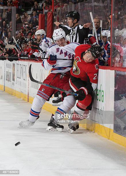 Kevin Klein of the New York Rangers bodychecks Curtis Lazar of the Ottawa Senators into the boards at Canadian Tire Centre on November 14 2015 in...