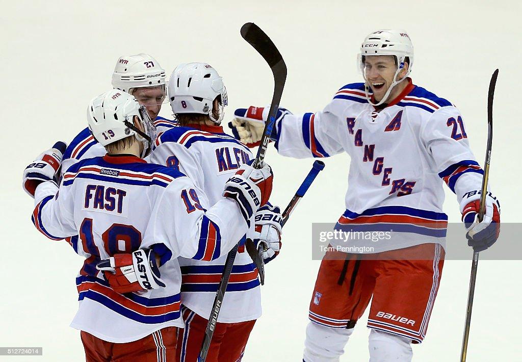 Kevin Klein of the New York Rangers celebrates with Ryan McDonagh of the New York Rangers Derek Stepan of the New York Rangers and Jesper Fast of the...