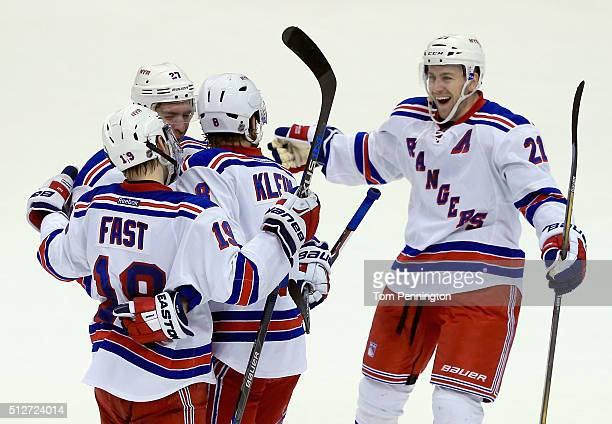 Kevin Klein of the New York Rangers celebrates with Ryan McDonagh of the New York Rangers Derek Stepan of the New York Rangers and Jesper Fast of the...