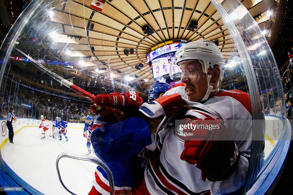 <a gi-track='captionPersonalityLinkClicked' href=/galleries/search?phrase=Kevin+Klein+-+Ice+Hockey+Player&family=editorial&specificpeople=4246372 ng-click='$event.stopPropagation()'>Kevin Klein</a> #8 of the New York Rangers checks Joakim Nordstrom #42 of the Carolina Hurricanes during their game at Madison Square Garden on November 10, 2015 in New York City.
