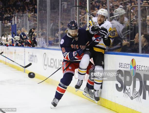 Kevin Klein of the New York Rangers checks Scott Wilson of the Pittsburgh Penguins during the first period at Madison Square Garden on March 31 2017...
