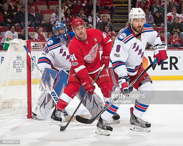 Kevin Klein of the New York Rangers defends against Luke Glendening of the Detroit Red Wings as he screens the view of goaltender Henrik Lundqvist of...