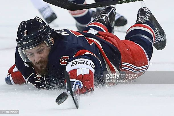 Kevin Klein of the New York Rangers dives for a loose puck against the Boston Bruins during the first period at Madison Square Garden on October 26...