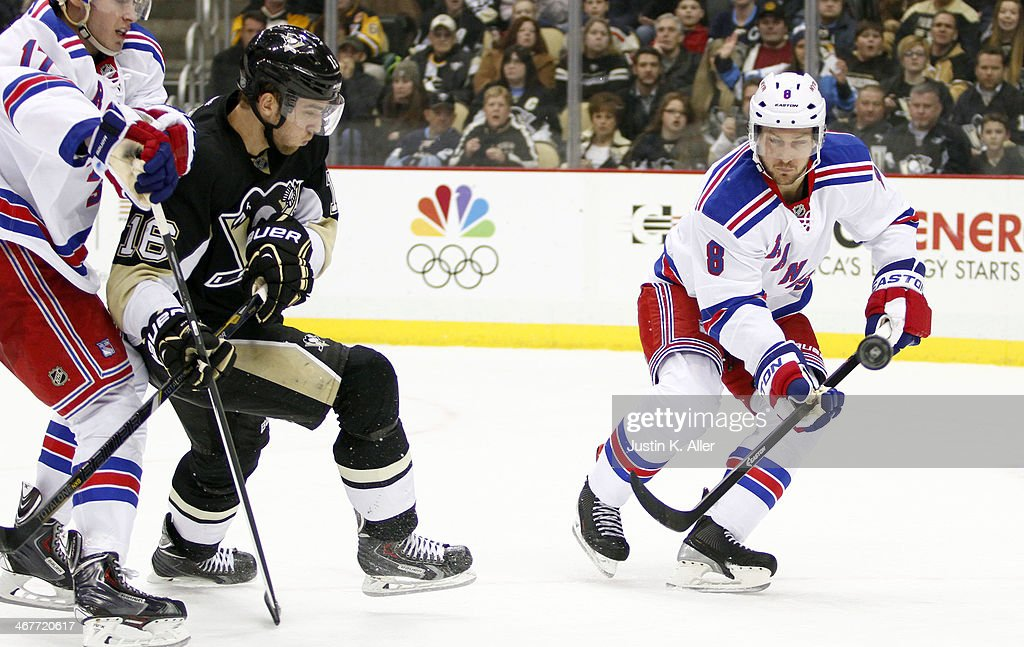 Kevin Klein #8 of the New York Rangers handles the puck in front of <a gi-track='captionPersonalityLinkClicked' href=/galleries/search?phrase=Brandon+Sutter&family=editorial&specificpeople=2086411 ng-click='$event.stopPropagation()'>Brandon Sutter</a> #16 of the Pittsburgh Penguins during the game at Consol Energy Center on February 7, 2014 in Pittsburgh, Pennsylvania.