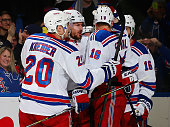Kevin Klein of the New York Rangers is congratulated by teammates Chris KreiderMarc Staal and Derick Brassard after Klein scored the game winner in...