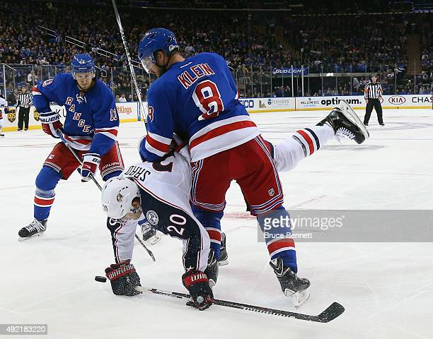 Kevin Klein of the New York Rangers upends Brandon Saad of the Columbus Blue Jackets during the third period at Madison Square Garden on October 10...
